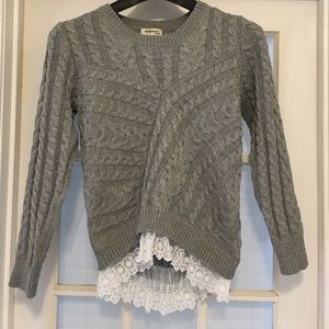 Grey knit sweater with white lace underlay